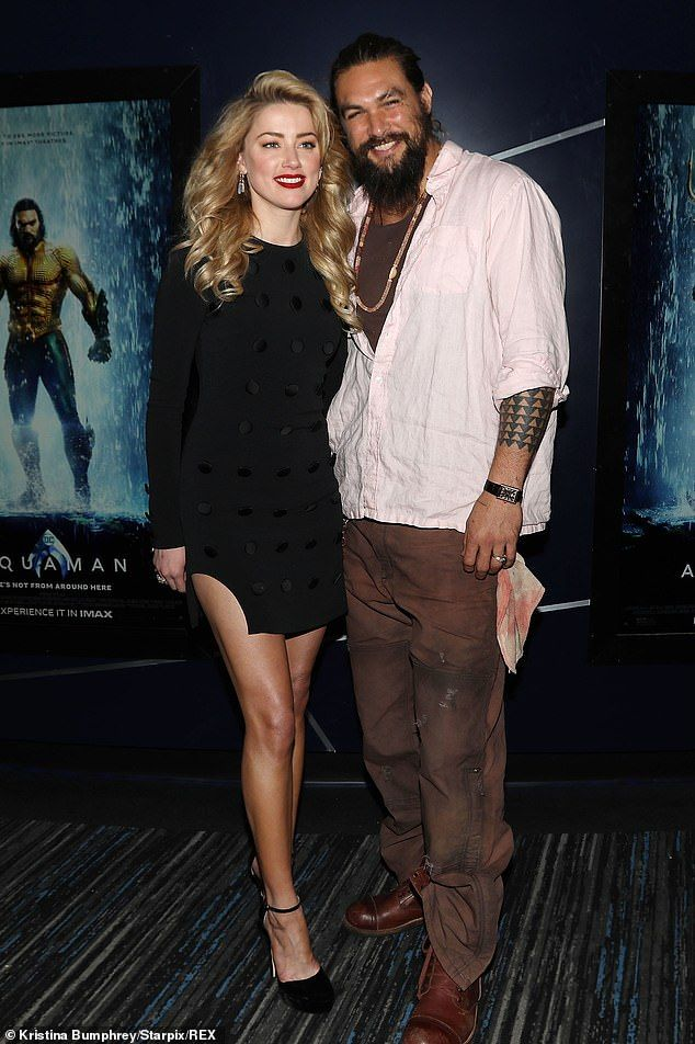 Jason Momoa poses with fans as Amber Heard gives leggy display at New York screening of Aquaman | Daily Mail Online