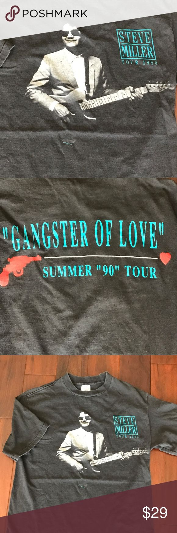 "Steve Miller Gangster of Love Concert Tee Cool vintage concert tshirt.  Steve Miller Band Gangster of Love Tour - 1990  Black.  100% cotton.  Short Sleeve.  Does have faded and a bit of pilling.  Armpit to armpit = 20.5"".  Length = 27"".  Shoulder to shoulder = 18"". Gurney Shirts Tees - Short Sleeve"