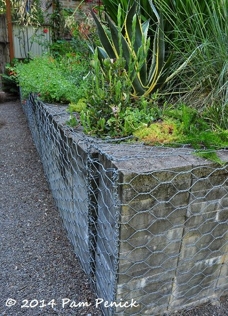 stacked concrete pavers bound gabion-style (could then grow ivy or moss on the chicken wire)