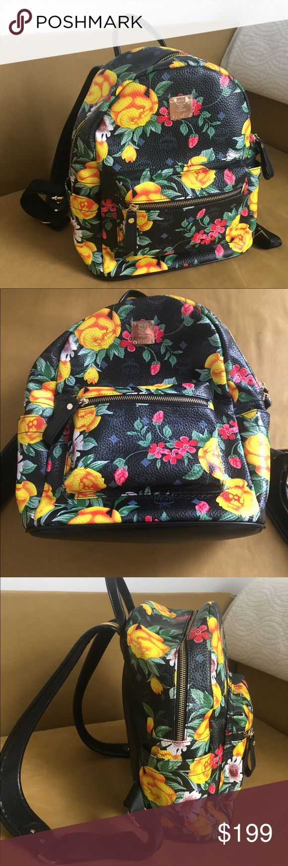 "MCM Floral Backpack Great condition! No tears or holes. All zippers in perfect working order. Bag hang loop shows minor signs of use. This gorgeous bag is a statement piece sure to strike up a conversation. Floral prints stands out bright against black pebble grain leather. Front side has large zip pocket. Inside has several pockets, zip and a divider for wallets. Fits 13"" laptop at an angle and easily fits 11"" laptop. MCM Bags Backpacks"