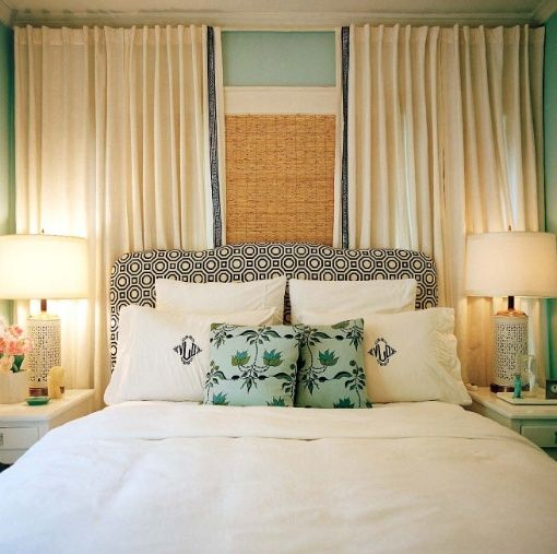 high curtain rod covering whole wall and love the fabric on headboard