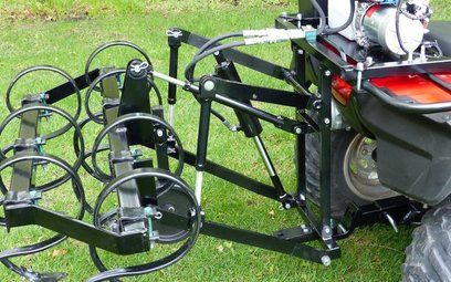 ATV quad bike with rear hydraulic cultivator attachment. The ATV Rear Hydraulic Cultivator attaches easily to a quad bike to transform it into a useful piece of farm equipment that will pierce, stir and pulverise the soil into a fine tilt ready for planting. For more info: http://www.fresh-group.com/atv-rear-hydraulic-cultivator.html
