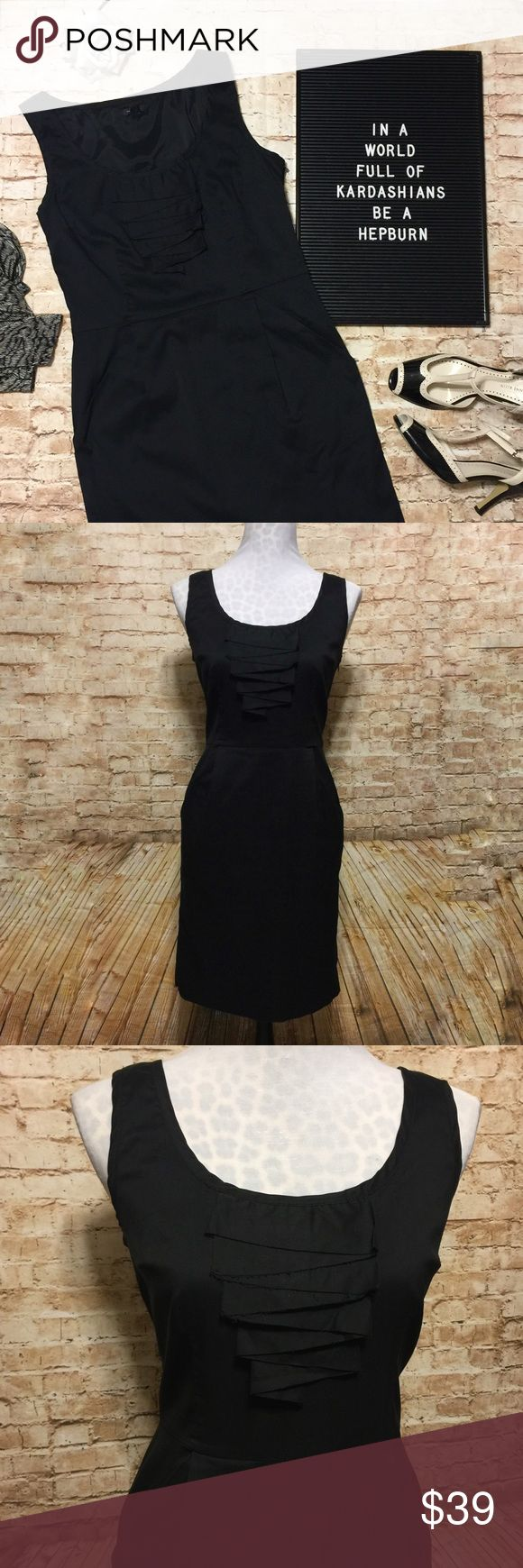 """Ann Taylor Classic Little Black Dress Beautiful LBD by Ann Taylor is the epitome of classy! Solid black with a tailored fit. Adorable raw-edge Ruffle Down the front. Side zipper. Pockets at each hip. Princess seaming and a pintucks at hips for a perfect silhouette. Defined waist. Modest round neckline. Flawless condition.   Measurements lying flat: • Bust: 17.5"""" across from armpit to armpit  • Waist: 15"""" at natural waist • Length: 37"""" Ann Taylor Dresses Midi"""