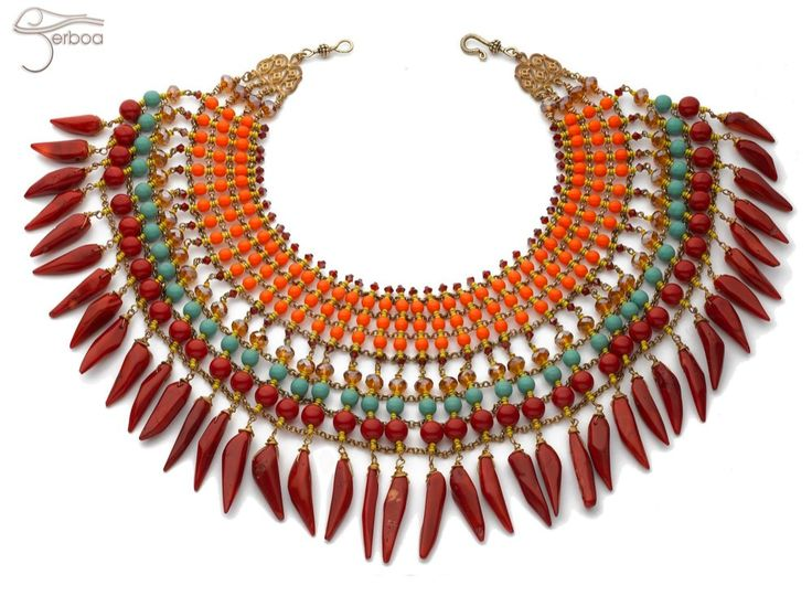 Chilli, our signature design is a show-stopping statement collar influenced by native American costume.  Over 1000 beads including genuine coral, spicy orange crystal and turquoise gemstone are combined with gold-dipped chain.  Drape over a simple T-shirt or embellish a stunning floor-length gown - just be prepared for lots of attention.  Chilli has a strong tribal essence, be sure to wear with plenty of warrior attitude!