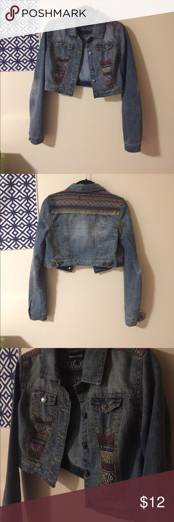 New Look crop jean jacket Love this jean jacket! Very cool tribal design on front panels and back shoulders. Last picture shows the length of the jacket! New Look Jackets & Coats Jean Jackets