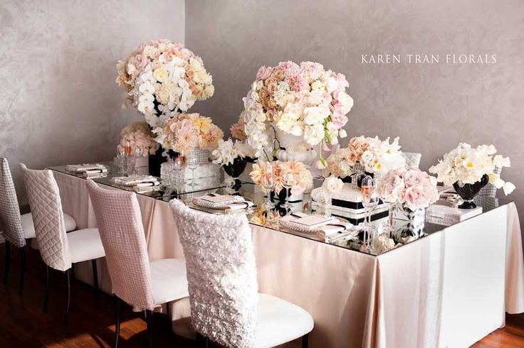 What if you had a blush table cloth and white lace runner with black touches, ie vase, place cards, with white full flowers? It's a little softer.