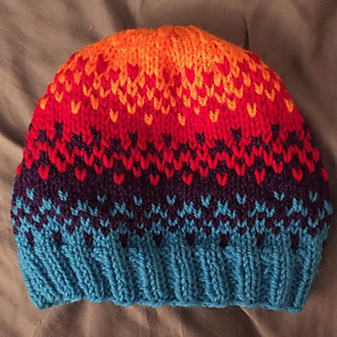 This quick pattern uses stranded knitting to blend four colors. Finished circumference 22 inches.