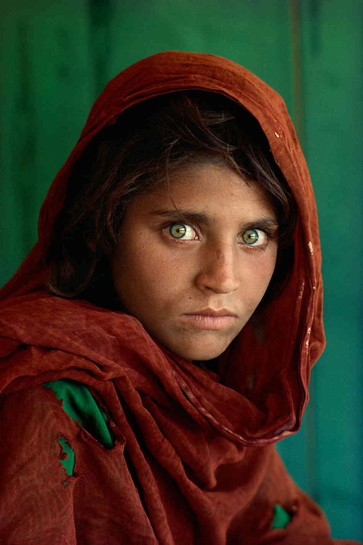 Of course this famous picture of the girl with green eyes isn't a headshot but the emotion that Steve McCurry and the girl have captured here are inspirational