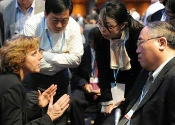 Environment News Service - Doha Outcome: Kyoto Protocol Lives, Global Climate Deal by 2015. European Climate Commissioner Connie Hedegaard of Denmark, left, consults with the Chinese delegation including Zhenhua Xie, right, at Doha, December 8, 2012 (Photo courtesy ENB)