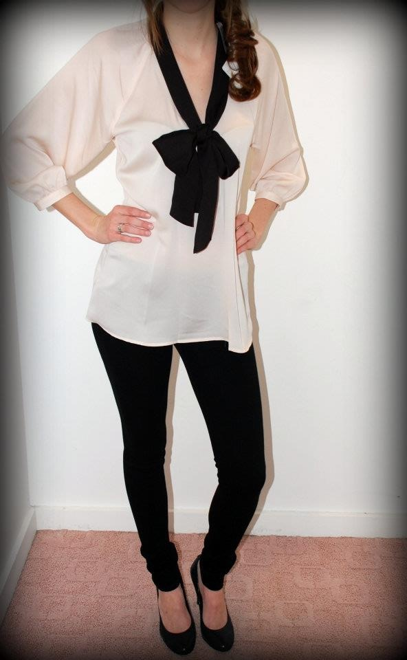 Central Park West cream top & Citizens of Humanity Avedon jeggins in black!  Outift price Orignally: $323.00  Sale Price: $215.00  Sizes: top-S, bottoms-25,26,28,30  www.mefashionboutique.com