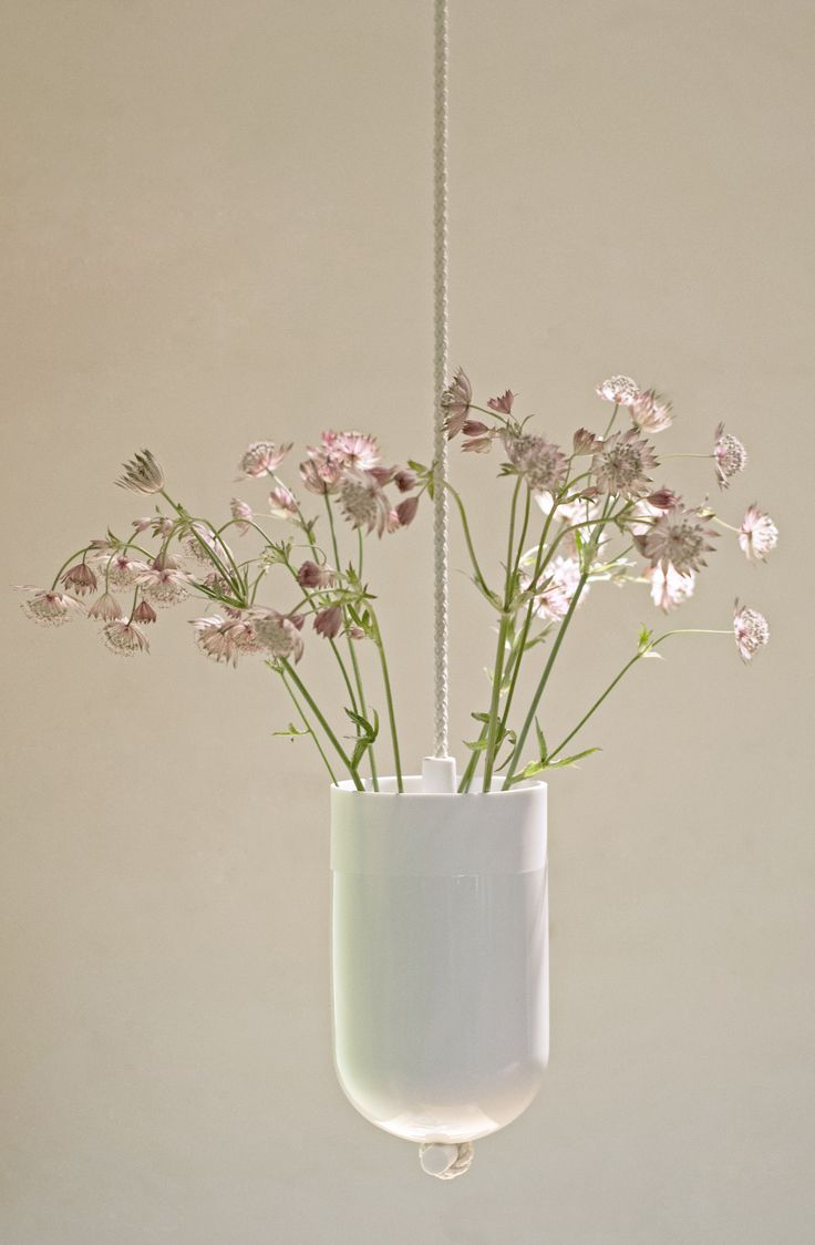 Spatial Vase  - Emphasizing the feeling of space and how we use space around us. The Spatial Vases involve the ceiling and wall literally into the living room, thus creating a more spacious feeling and making the interior less static.  www.lottedouwes.nl