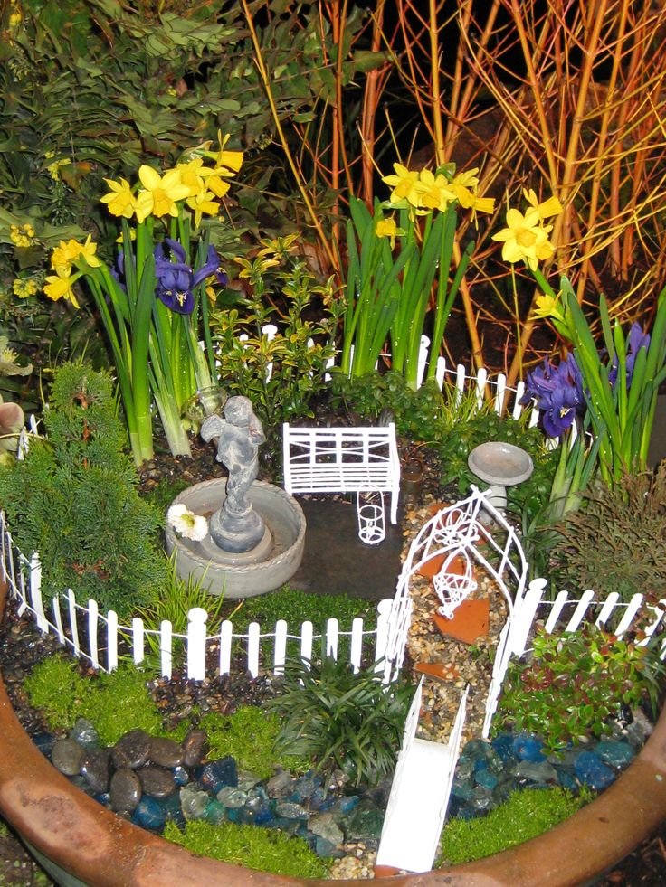 Awesome White Wooden Fencing Around And Lovely Mini Flowers As Fairy Garden Ideas