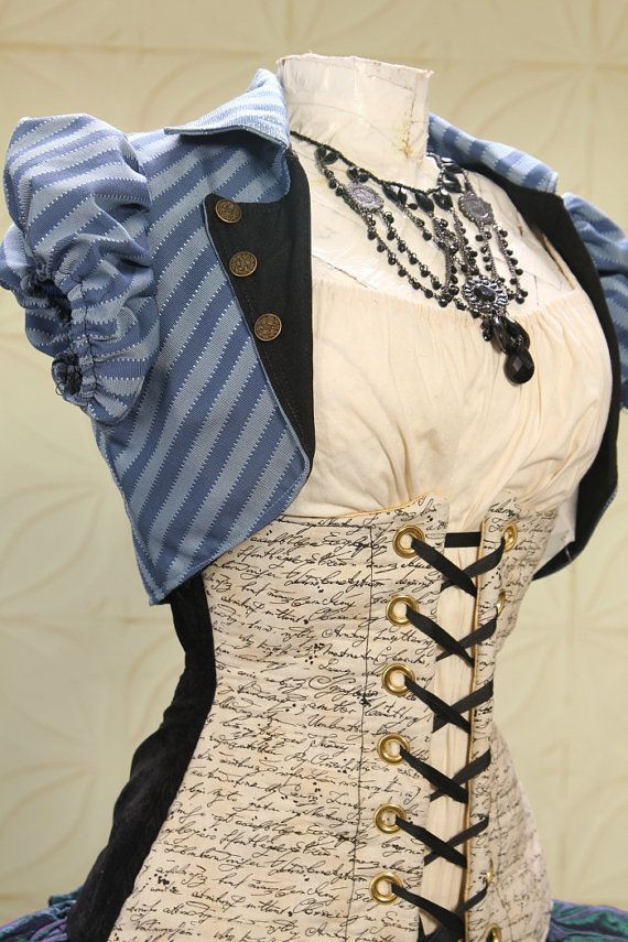 Love the script fabric on the corset.   Would be cute for a steampunk librarian outfit.
