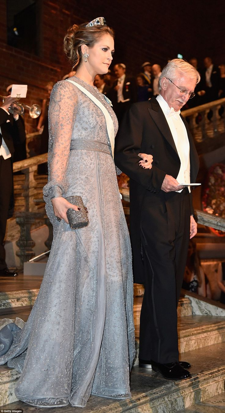 Princess Madeleine, who is married to an American financier, wore racy dark nails with her delicate gauzy gown and stunning headpiece
