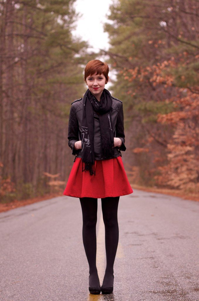 Pixie haircut, matte leather jacket, red dress and black tights. Perfect girl.