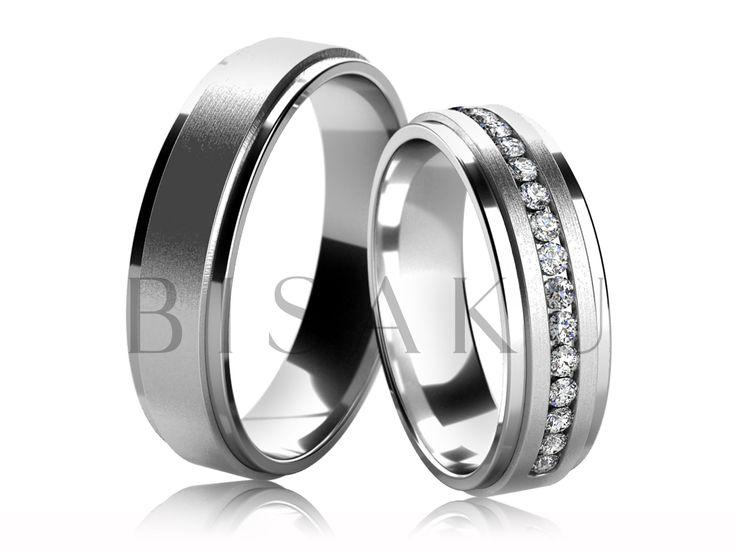 4565 Snubní prsteny z bílého zlata, jejichž prostřední část je profilově lehce vyvýšena a tím se saténově matné provedení povrchu opticky odlišuje od krajů, které jsou řešeny ve vysokém lesku. Dámský prsten je do poloviny zdoben kameny. #bisaku #wedding #rings #engagement #svatba #snubni  #prsteny