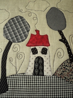 Black and white primitive like house and trees wall hanging or a square.