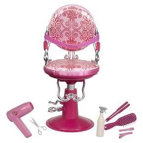 Pamper your OG Doll and give her a new look in the Our Generation Salon Chair. This pretty pink chair fits 18-inch dolls and has everything youll need for a fun day at the salon. The chair looks like the real thing and comes with scissors, a hair dryer, a straightening iron, a brush, 2 hair clips and a spray bottle. Create fun styles and lots of memories with your American Girls doll. For every OG purchase, 10¢ goes to Free the Childrens Power of a Girl Initiative. Ages 3 and up.