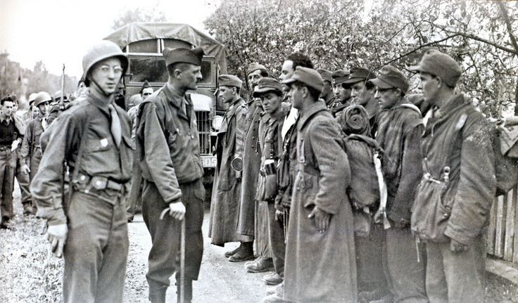 Captured soldiers of the French Waffen SS Charlemagne division are presented to Free French Forces General LeClerc in Berlin. All were shot afterwards. They should've been given a break since they only fought against the Soviets.