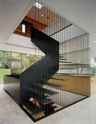 Solid wall balustrade and cable balustrade creating a very lightweight looking staircase. Via Gluck Partners
