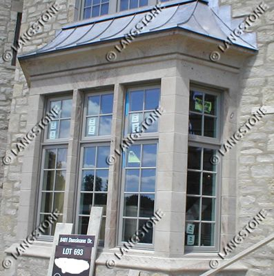 Butler Sandstone window surround with lintels, mullions, and sills. For more home decor ideas visit www.langstone.com