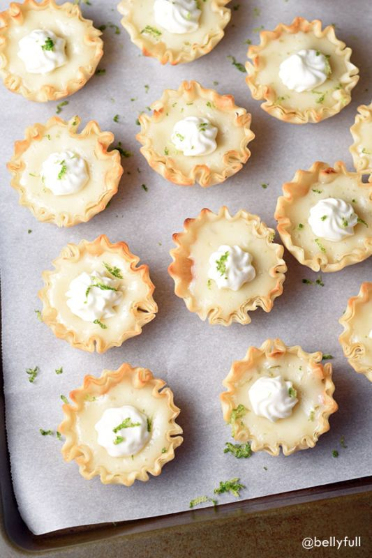 Small fillo shells are filled with a lime custard and topped with whipped cream and zest!Hi gang! How was your holiday? Were you smart and took Tuesday off from work to recover? I apparently had a major...