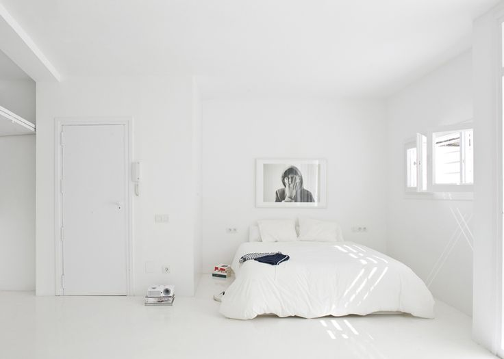 The White Retreat is a seaside studio apartment by Colombo and Serboli Architecture.