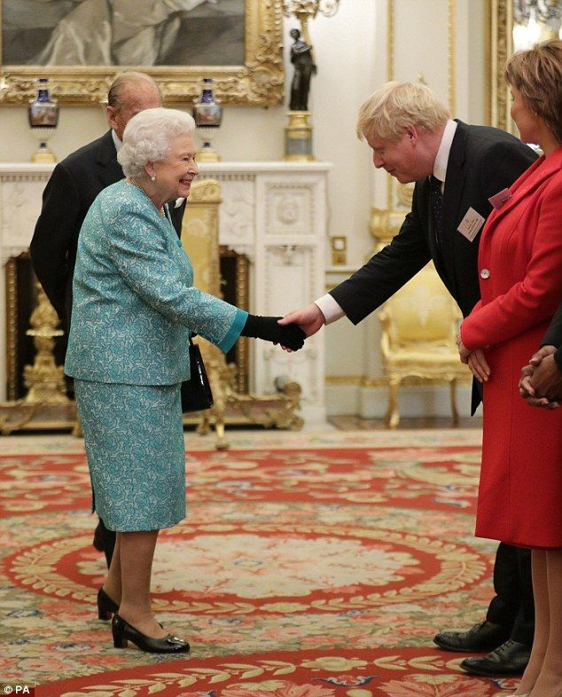 The Queen shakes hands with Foreign Secretary Boris Johnson...