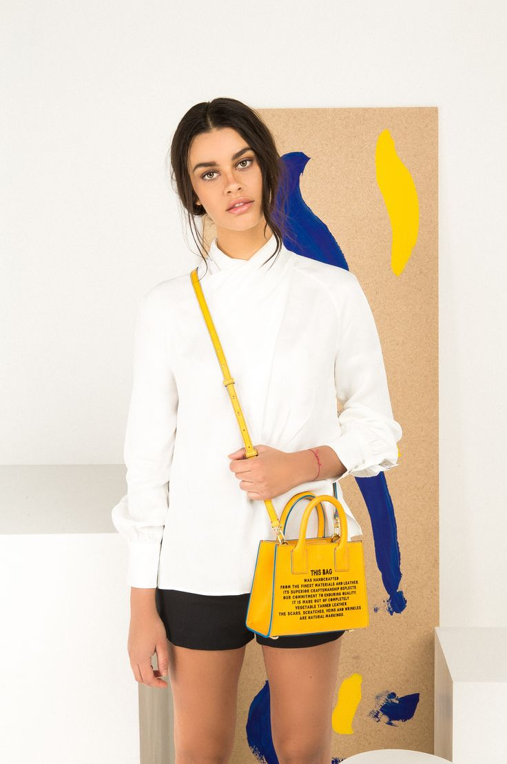 Mini Tote - Yellow  £495.00  H15.5cm x W20.5cm x D7.5cm  Sunflower-yellow, Italian vegetable-tanned calf leather.  Laser-cut disclaimer front and unique barcode on the side.