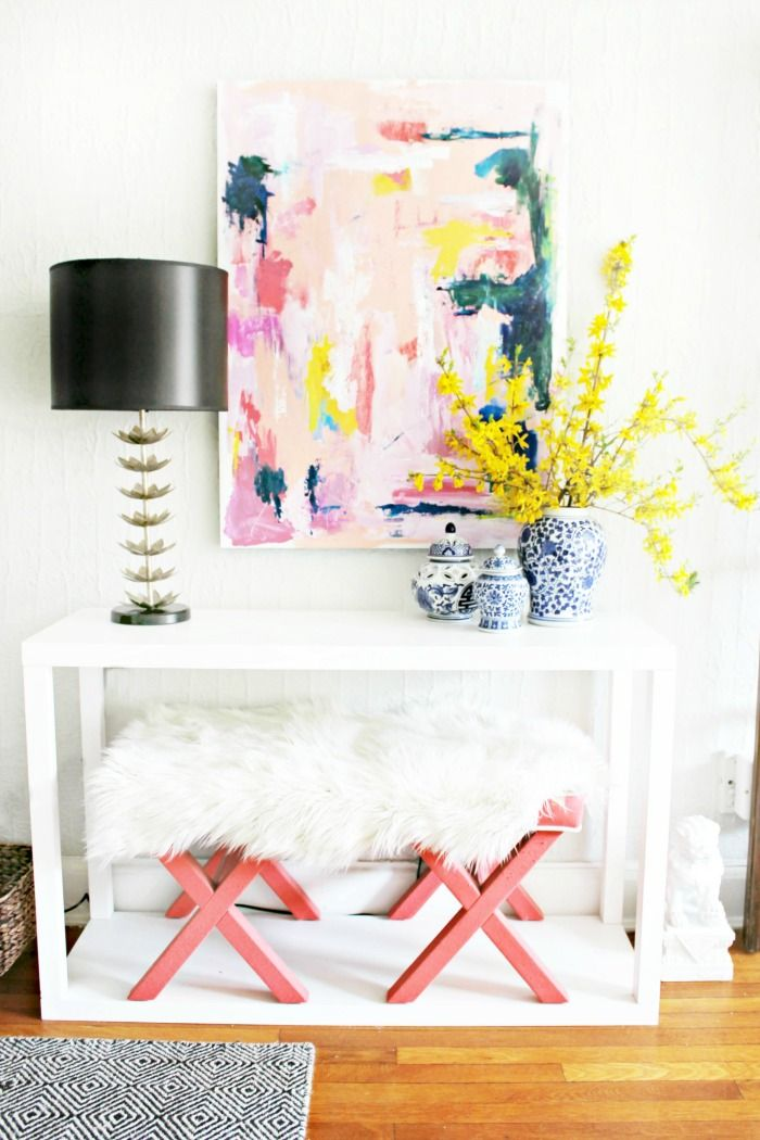 This entryway is gorgeous. Love the abstract art