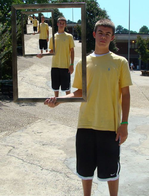 """Second PhotoShop project. They each took photos of themselves with a frame. They could then change either the inside, outside, or both backgrounds of the frame as long as it showed a part of their personality."" - View 1"
