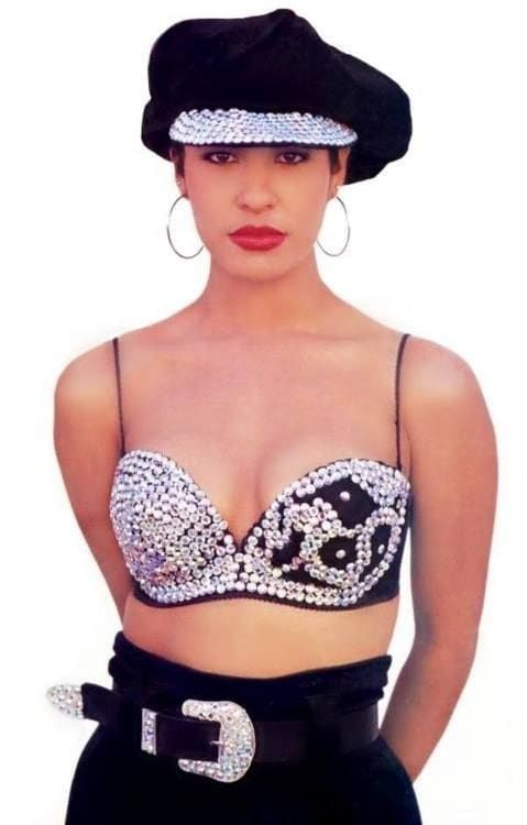 Military hat, cowboy belt, hoop earrings and a bustier? Only Selena knew how to combine all of those and make it look damn good!