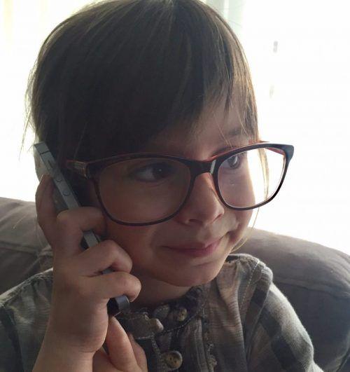 Girl talking on mobile phone . health danger for children