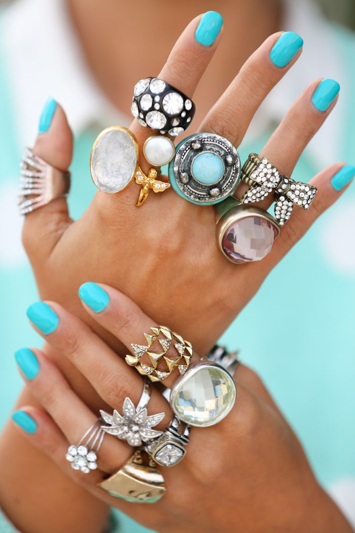{ I know this is too much but i just love the picture!!!!!! }Angel ring by Toosis via Boticca | House of Harlow pyramid wrap ring | Lucky Brand large turquoise ring| Fossil large gold ring| Robert Lee Morris silver crystal pave flower ring| Lucky Brand silver & pink large quartz cocktail rings| Large black & crystal ring - old| Nails: Illamasqua nail polish in robin egg blue