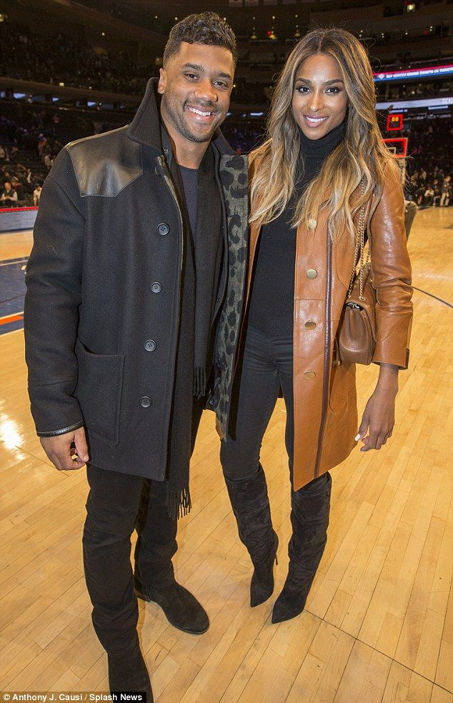 Old-school: NFL player Russell Wilson, who is pictured with girlfriend Ciara at a New York Knicks game earlier this month, revealed last summer than the pair are abstaining from sex until they potentially get married