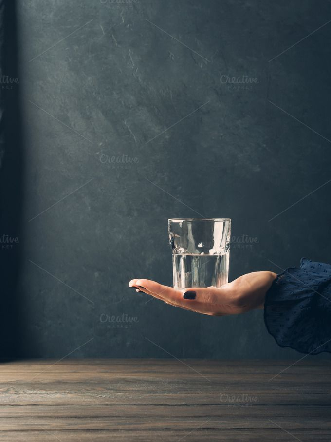 Glass of water in woman's hand by Life Morning Photography on @creativemarket