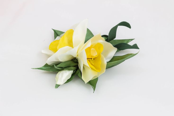 A personal favourite from my Etsy shop https://www.etsy.com/ie/listing/589083717/lovely-daffodils-brooch-kanzashi-silk
