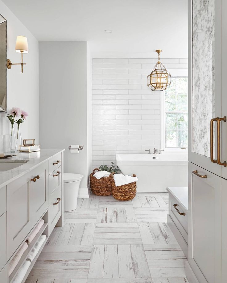 Spa bathrooms we cannot get enough of! Take a look at these 7 elegant bathroom designs that incorporate white, neutrals and grays, along with pink and blush, as well as wood floors, chevron tiles, a twist on subway tiles, dark blue walls, marble counters, exposed pipe sinks and standalone tubs.