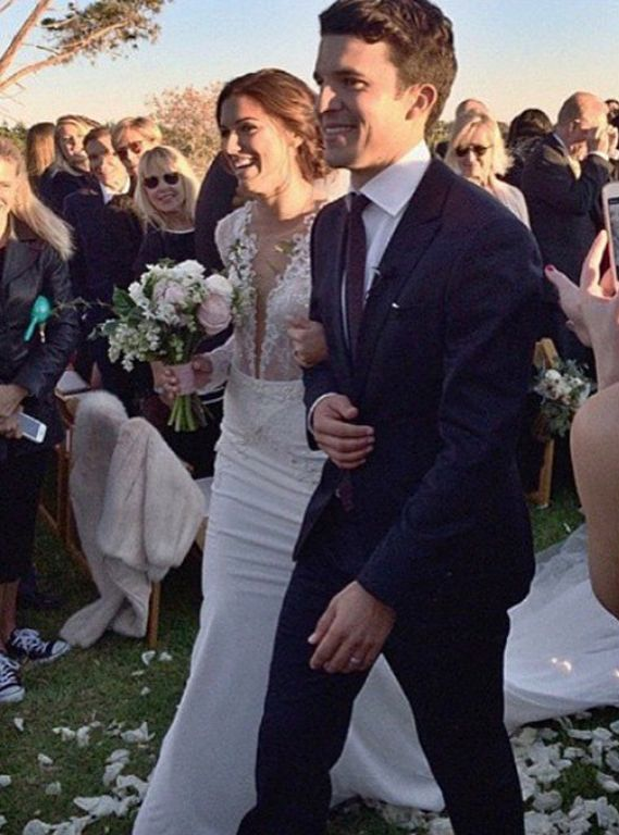 Us Soccer player Alex Morgan in Berta Bridal lace wedding dress