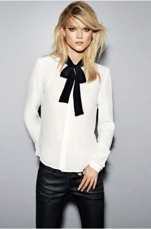 Business casual work outfit: white tie neck blouse, black skinnies.