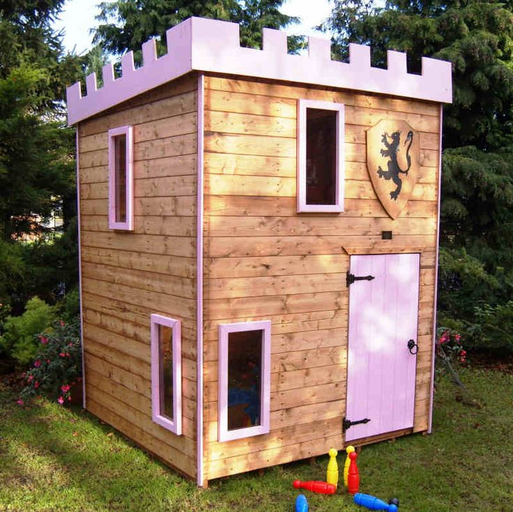 "The Castle Tower is a double storey Playhouse 6' x 6' x 8'5"" supplied with internal floors, ladder leads to second storey play area with safety rail. Four fixed windows glazed in perspex. Outward opening door. Supplied stained in a light oak basecoat. Optional two-tone paint in blue or pink, optional coat of arms shield."