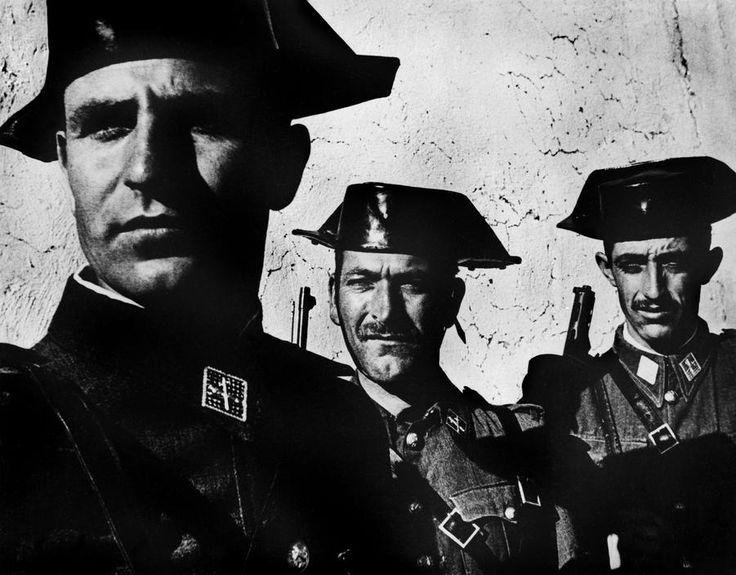 "W.Eugene Smith Photographer http://territoriotoxico.wordpress.com/ SPAIN. Extremadura. Province of Caceres. Deleitosa. 1951. Members of the Guardia Civil, the rural police force in charge of patrolling the countryside. From ""Spanish Village"" photo-essay."