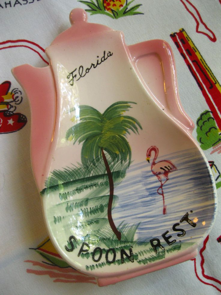 Vintage Florida souvenir spoon rest with flamingo and palm tree - 1950s pink ceramic  https://www.etsy.com/listing/165652973/vintage-florida-souvenir-spoon-rest-with?ref=shop_home_active