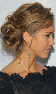 I think you should do something like this. Chignon but slightly messy. With flowers if you still want that.