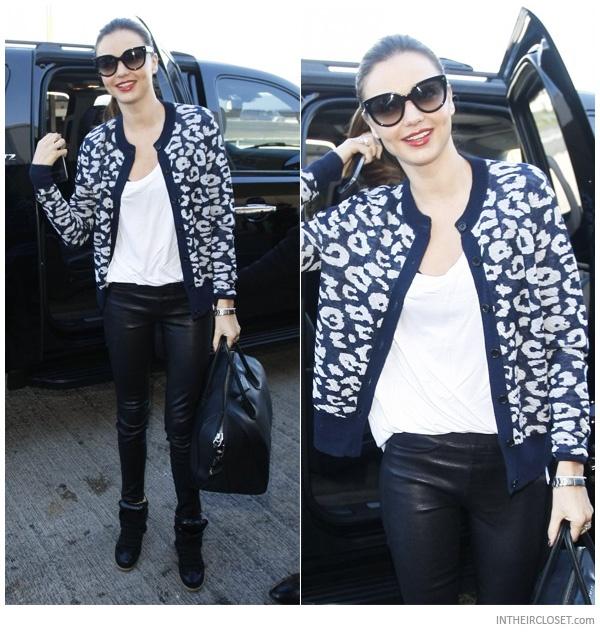 Miranda Kerr - airport chic.   Prada sunglasses, A.L.C. Austin cardigan, Helmut Lang leather pants, Isabel Marant Bekket wedge sneakers,  Givenchy Antigona bag
