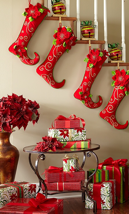 Pier 1 Poinsettia Stockings hang on Glitter Bell Stocking Holders above a Chasca End Table