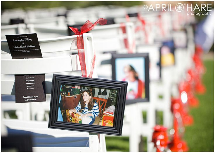 Red lanterns and framed photos of the bride & groom as kids lining the aisle, with programs tucked into the chairs! (AprilOharePhotography.com)