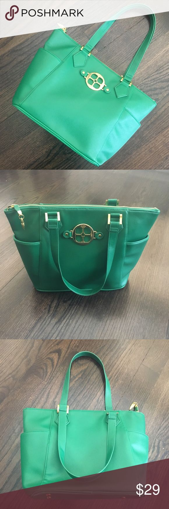 NWOT Iman Green & Gold Zip up Tote Bag New, never used. Green faux leather zip up Tote by Iman. Gold hardware. Interior is fully lined and has a zip pocket and 2 cell pockets. Iman Bags Totes