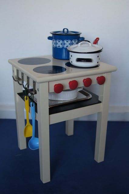 "Materials: ODDVAR stool, BLECKA hooks, wooden knobs, board, paint color Description: 1. Assemble Oddvar.2. Paint it. 3. Paint the wooden knobs. 4. Paint the hotplates (I used CDs and plates as templates). 5. Screw on the hooks and knobs. 6. Fit in the ""oven""-board and paint it! 7. Let your children have fun!! ~ Verena, [&hellip"