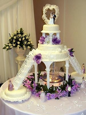 Round Fountain Wedding Cake | The bride and groom chose a fondant design, with filigree stairs by ...